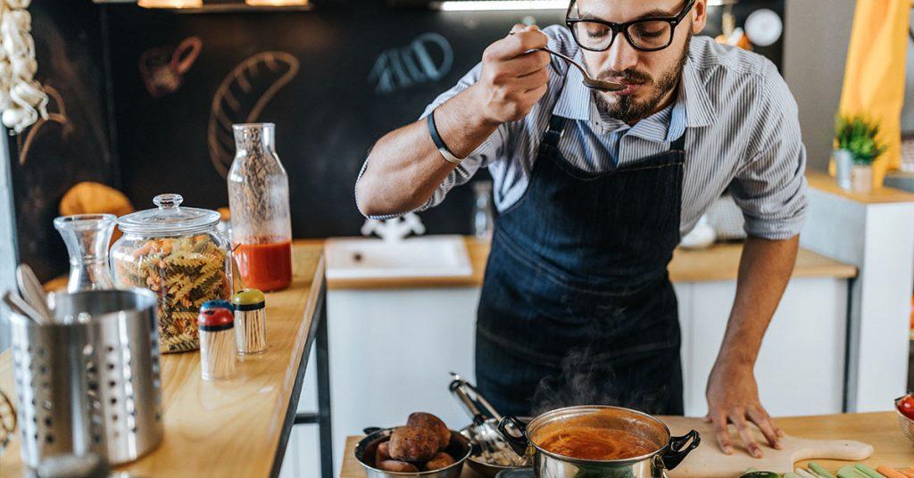 A man cooking soup.