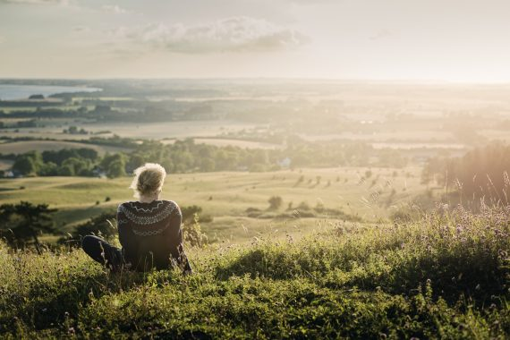 Portrait of a mature woman looking out over the countryside.